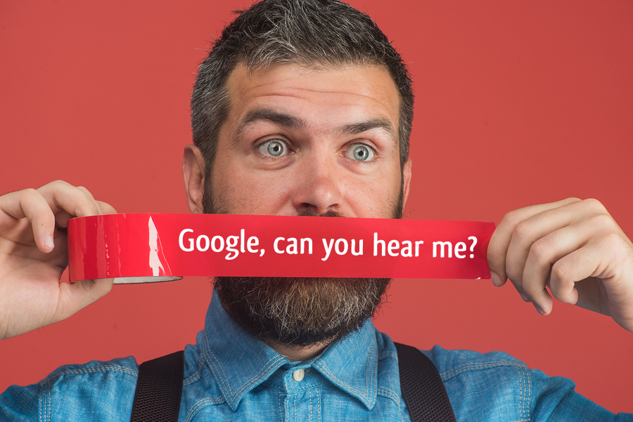 "Beard guy with some red duct tape over his mouth. It says ""Google, can you hear me?"""