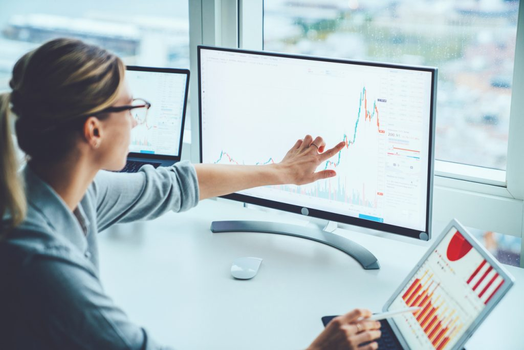 business woman seeing improved ROI on a line chart